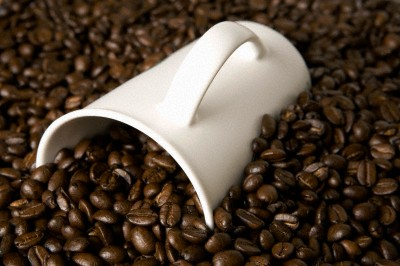 A cup in coffee beans